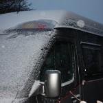 Sunset Camper in de sneeuw